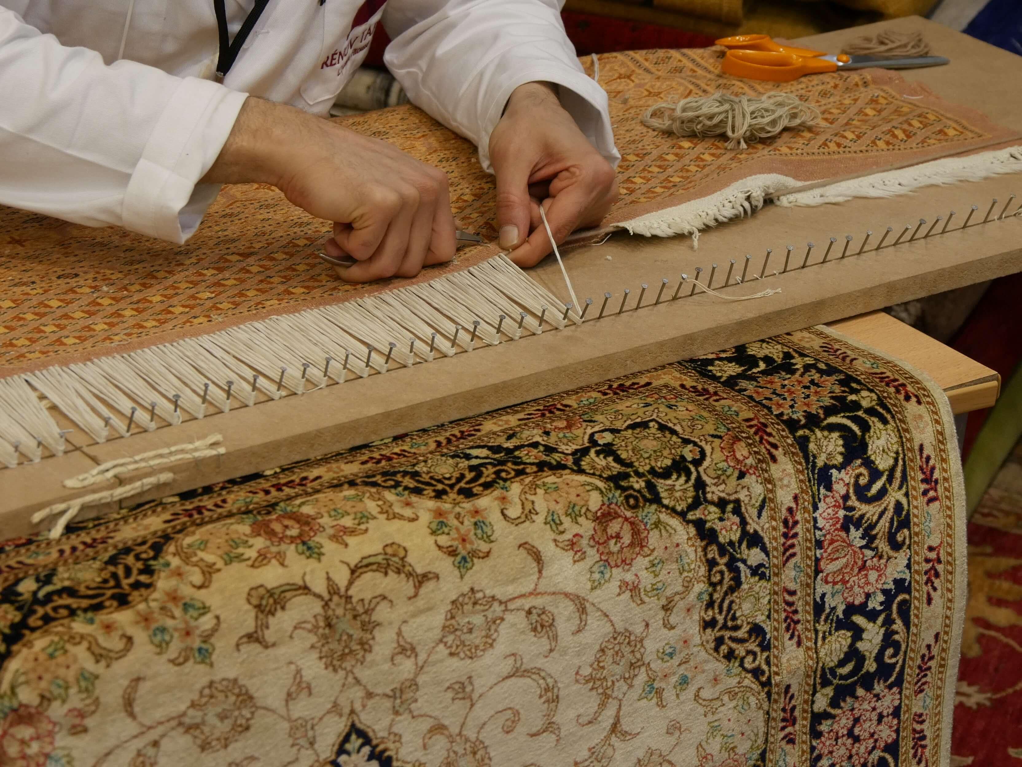 Réparation de tapis